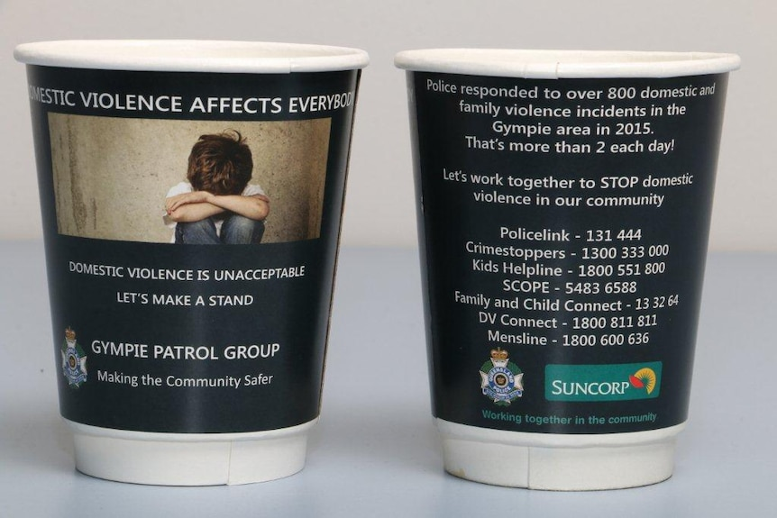 Takeaway coffee cups printed with domestic violence message and information
