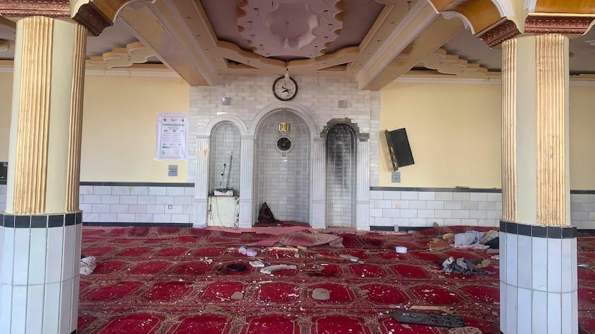 Debris inside a Kabul mosque after a blast