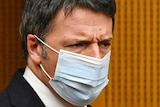 Close up of man's face wearing mask.
