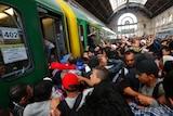 Asylum seekers storm a train at Keleti station, Budapest