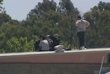 Inmates on the roof of the Malmsbury Youth Justice Centre.