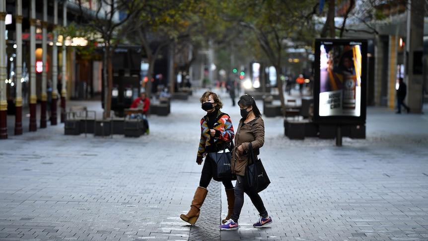 Two women walk down Pitt St Mall