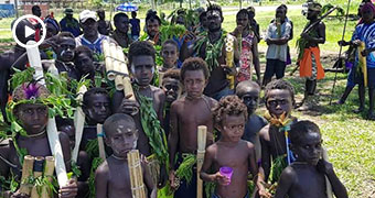 A group of children in the foreground at a reconciliation ceremony in Bougainville.