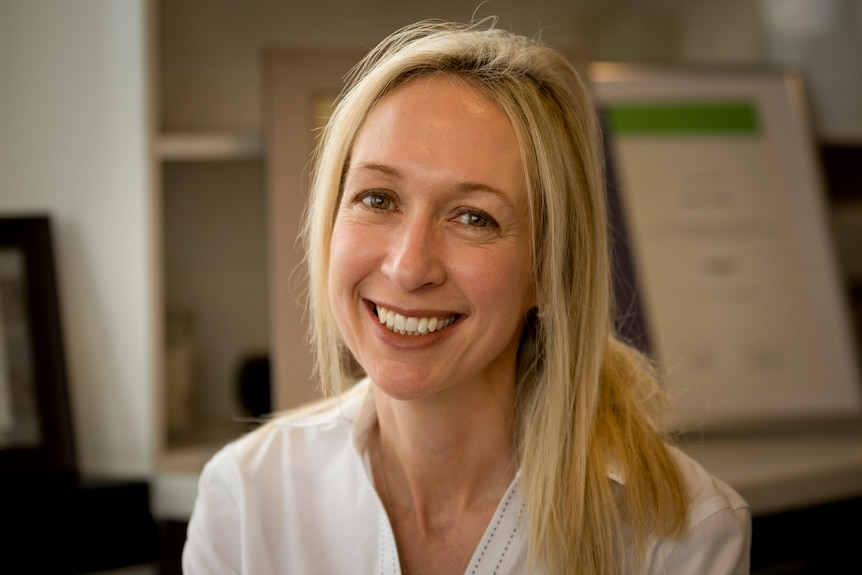 Jodie Lowinger looks at the camera in her office in Sydney.