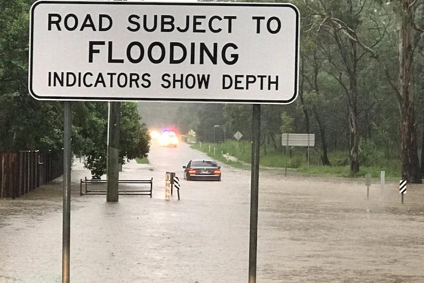 Car stranded in flood waters