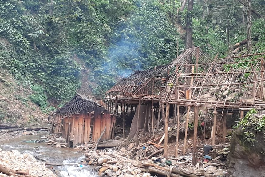 Two structures stand with significant damage in the landslide aftermath in PNG.