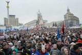 Ukraine protesters clear city hall