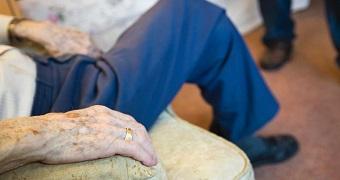 Close up of elderly man's hand in nursing home.