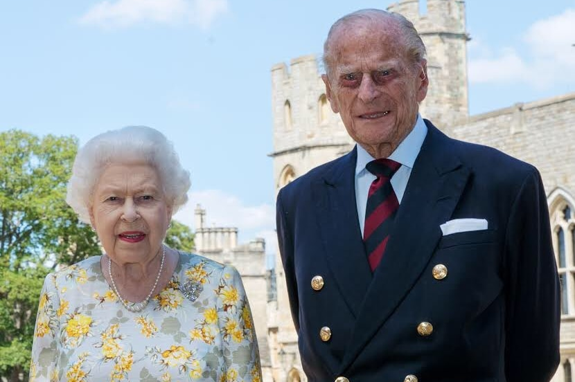 A photograph of Queen Elizabeth II with her husband the Duke of Edinburgh, Prince Philip, in the quadrangle of Windsor Castle.