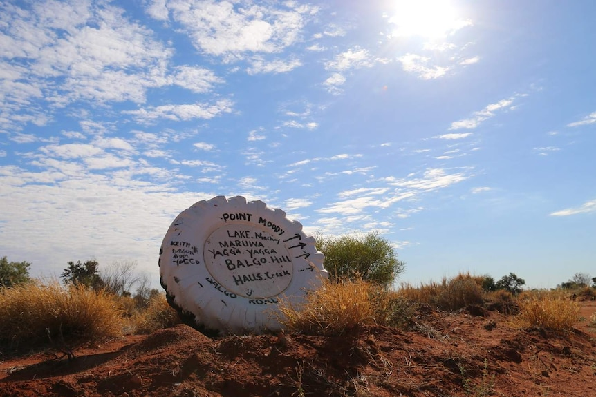 A sign pointing to the remote Lake Mackay.