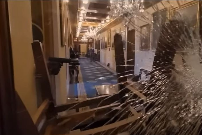 A screenshot of a broken window in the US Capitol building