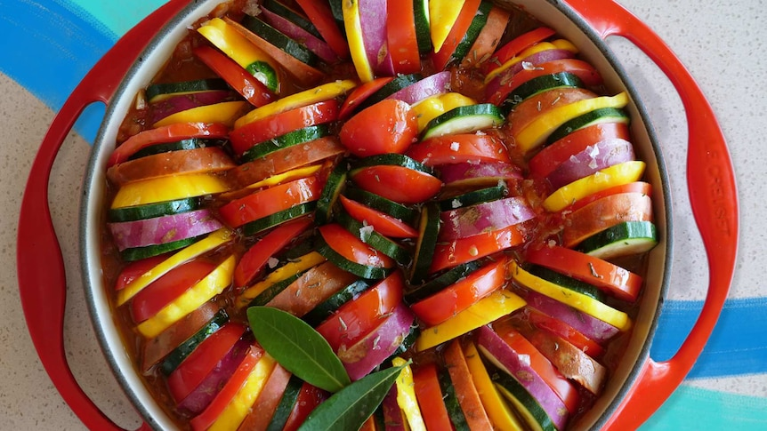 Slices of vegetables in a baking tray ready to be baked into a vegetarian recipe for a sharing.