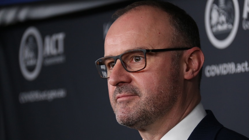 Close up of Andrew Barr at a press conference.