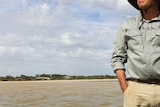 David Paton stands in the coorong river