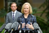Dr Jeannette Young speaks at a press conference at Parliament House in Brisbane.