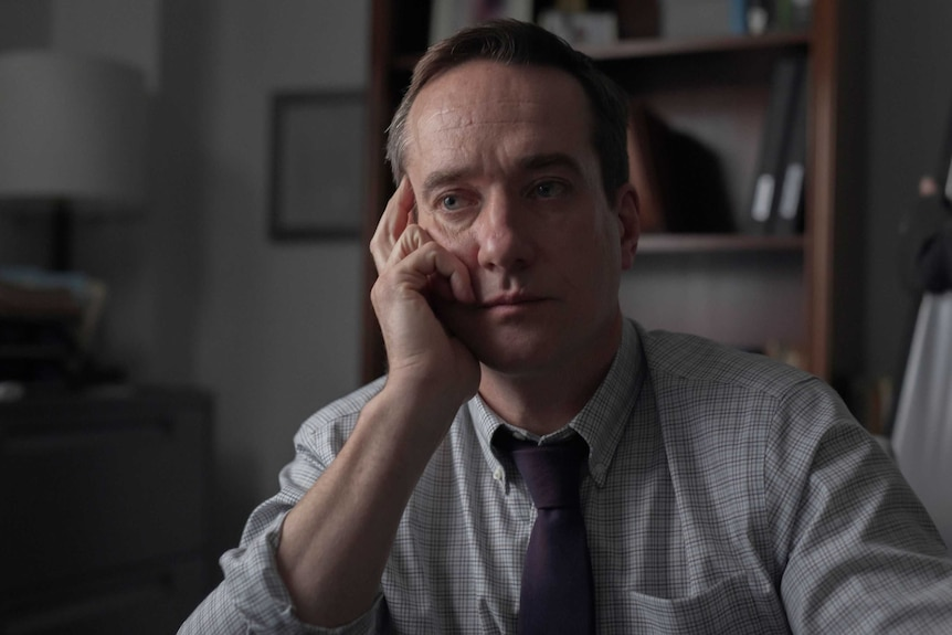 Actor Matthew Macfadyen in the film The Assistant, playing an HR boss in a shirt and tie