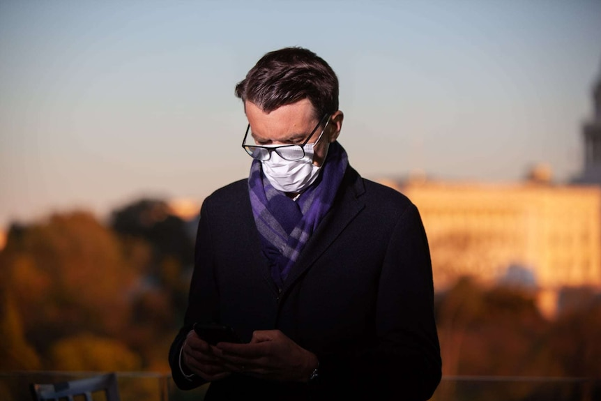 Michael Rowland wearing a mask in the US.