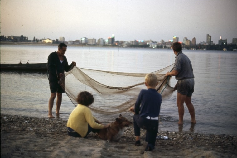 A family prawning a dusk in the Swan River, 1968-1970