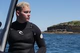 Gamay Ranger Bryce Liddell sits on his boat at Botany Bay.