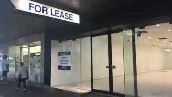 A shop sits empty and for lease on a Darwin shopping strip.
