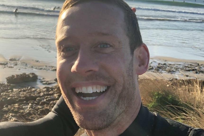 Melbourne surfer Mark Quinn throws the 'hang loose' shaka sign.