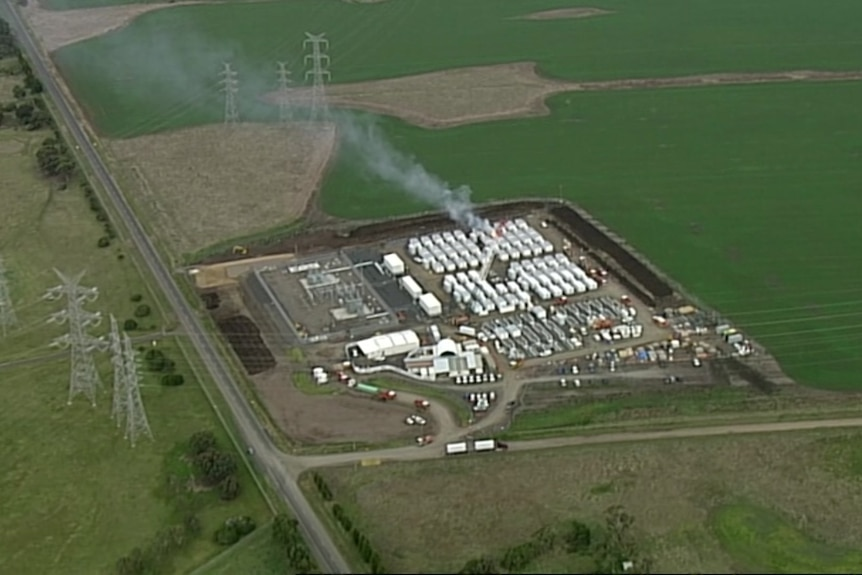 An aerial photo showing an industrial site with a small plume of smoke.