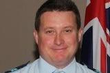 Queensland Police Service Senior Constable Brett Forte holding a medal