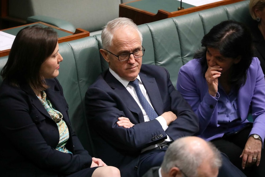 Julia Banks whispers to Malcolm Turnbull, while Kelly O'Dwyer listens in