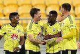 Wellington Phoenix celebrate a goal against Brisbane Roar