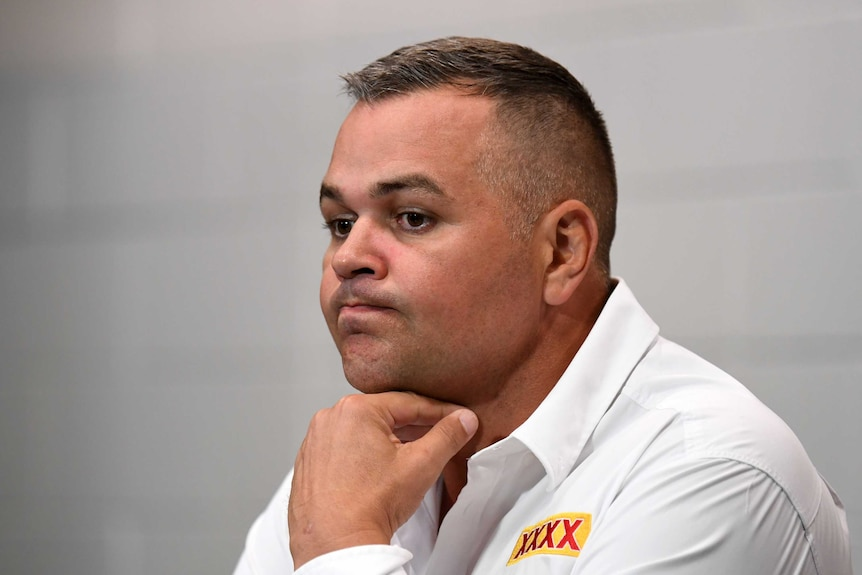 Anthony Seibold holds his hand under his chin and purses his lips