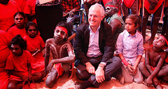 Malcolm Turnbull poses with Aboriginal children