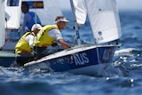 Two Australian sailors sit side by side as they race in the Olympics.