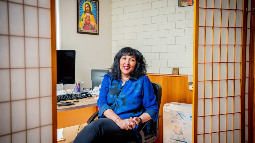 A woman in her office