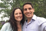 A smiling man and woman take a selfie