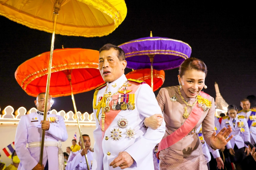 The Thai King and Queen surrounded by colourful umbrellas