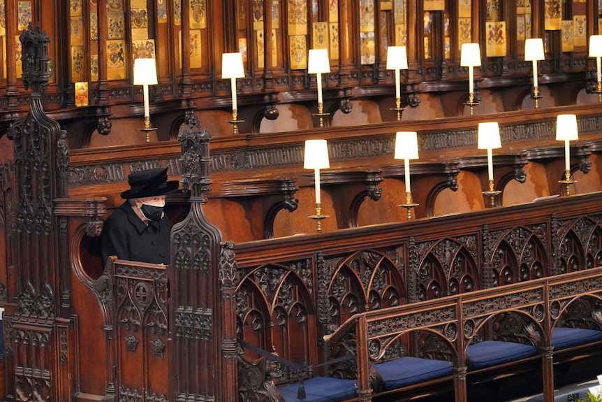 The Queen sits alone at Prince Philip's funeral.