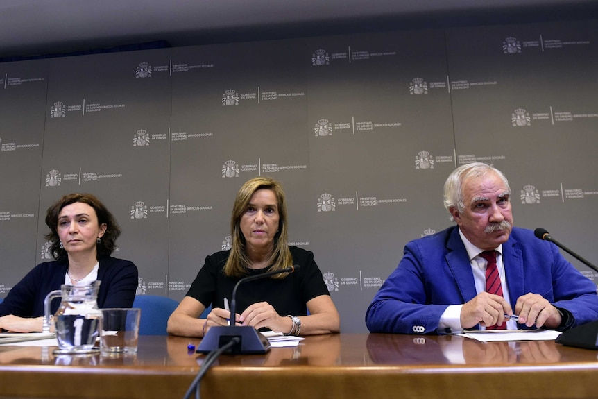 Spanish health officials media conference.jpg