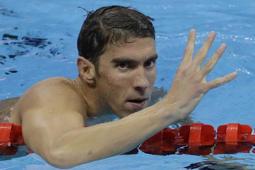 Michael Phelps celebrates winning gold in the men's 200-metre individual medley.