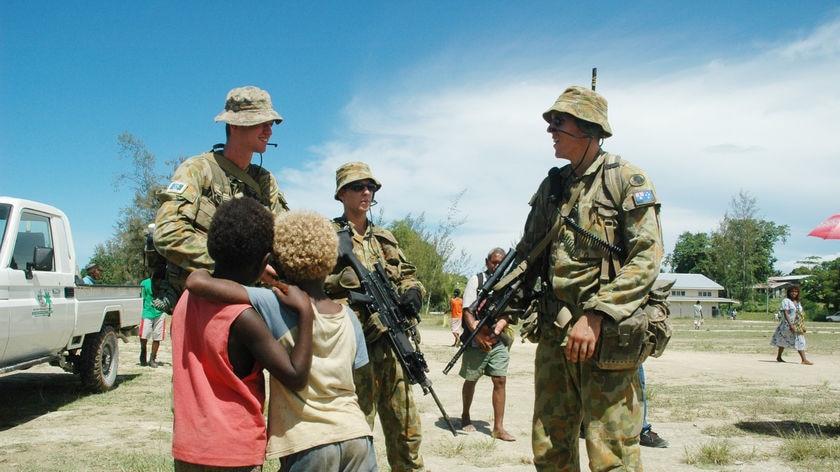RAMSI soldiers patrol Auki