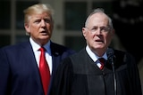 US President Donald Trump listens as Justice Anthony Kennedy speaks.