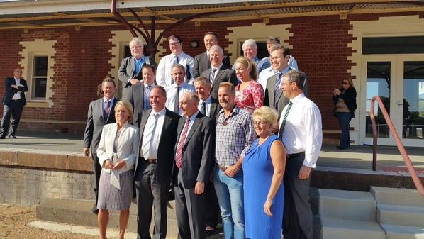 National Party federal MPs stand posing for a group photo at Wodonda train station.