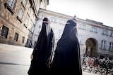 Women in niqabs at Christiansborg Palace in Copenhagen, Denmark.