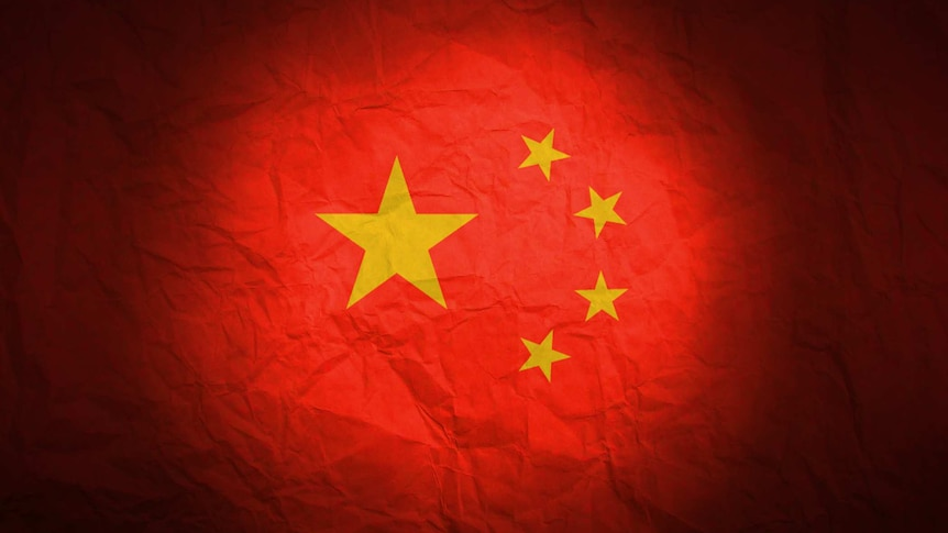 Graphic of China's Flag looking crumpled lit with a spotlight.