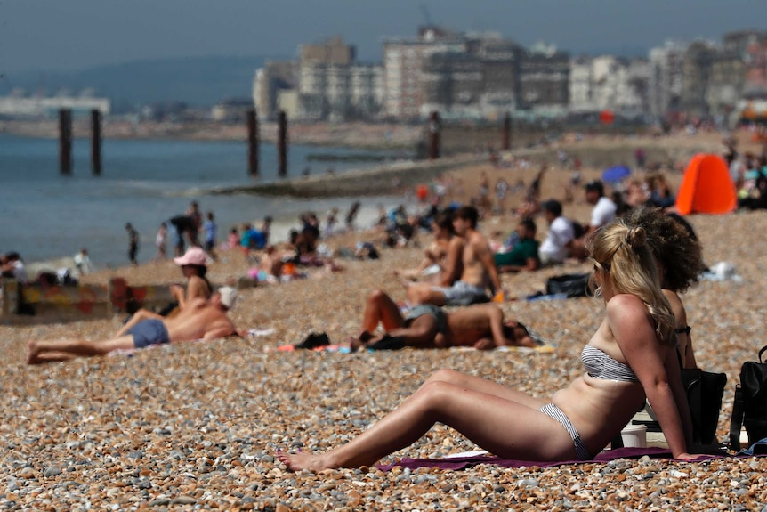 Brighton sunbathing after coronavirus measures eased