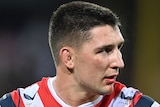 A Sydney Roosters NRL player stands with his hands on his hips after being placed on report.