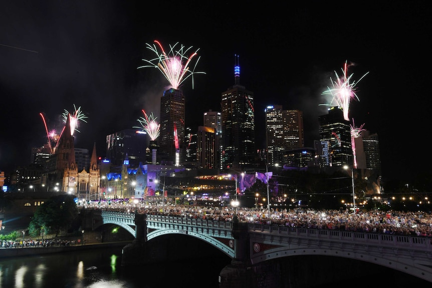 Fireworks explode over the Princes Bridge during in Melbourne at night
