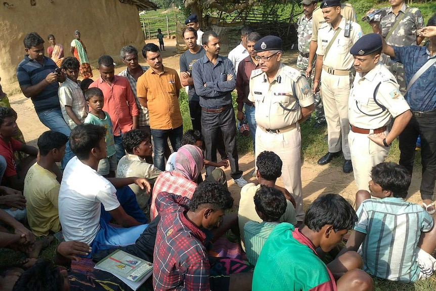Indian police speak to villagers following witchcraft killings