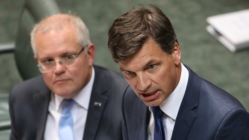 Angus Taylor speaks at the despatch with Scott Morrison looking on behind him