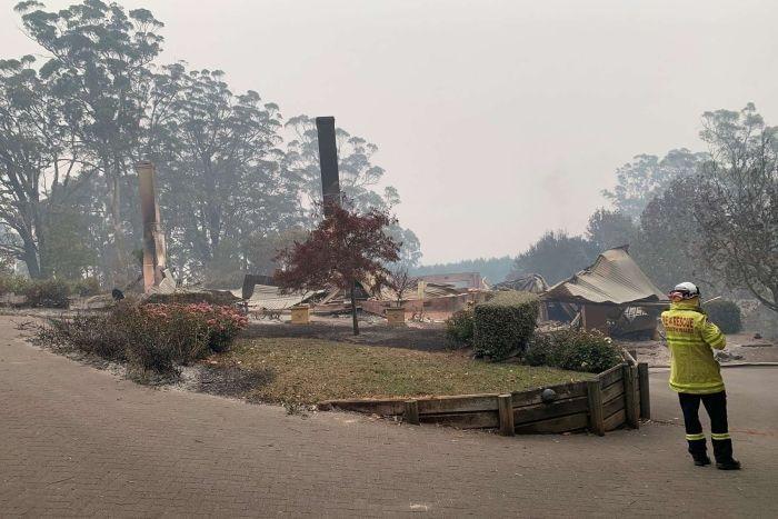 A razed home in a smoky haze.