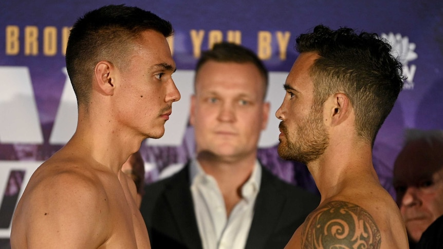 Tim Tszyu and Bowyn Morgan stand face to face at the weigh-in before their boxing fight. Promoter Ben Damon is in the middle.